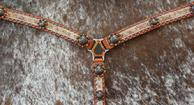 Belt style breast collar with light brindle hair-on, Fire opal Swarovskis and Ant. bronze hardware.
