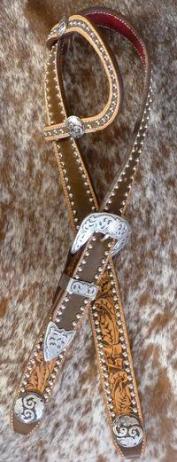 Hand tooled and dyed belt style headstall w/ single ear, scroll conchos and three piece buckles.