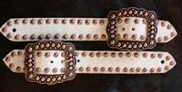 Belt style spur strap. White hair-on hide and Ant. Bronze fancy spots and Buckles.
